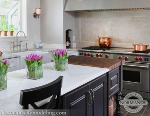 Kitchen Island Benefits from Mixing Wood and Stone Countertops