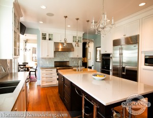 chandelier and pendant lighting in kitchen created by Normandy Designer Chris Ebert