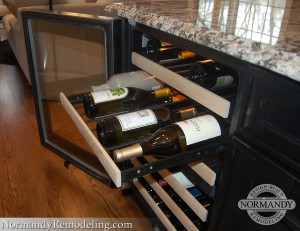 Wine refrigerator in island created by Normandy Designer Ann Stockard