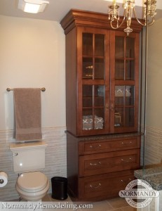 Armoire in bathroom ideas created by Normandy Designer Laura Barber AKBD
