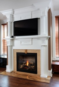 Traditional style fireplace with TV above