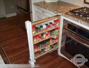 decorative cabinet column with pull out spice storage next to stove