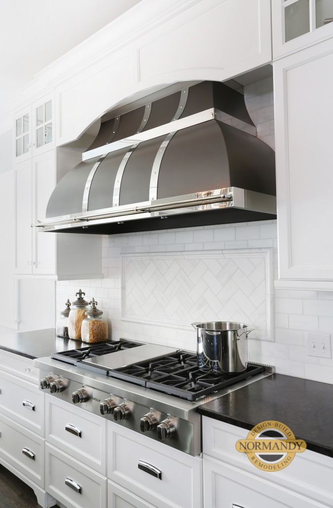 Range with black and silver hood