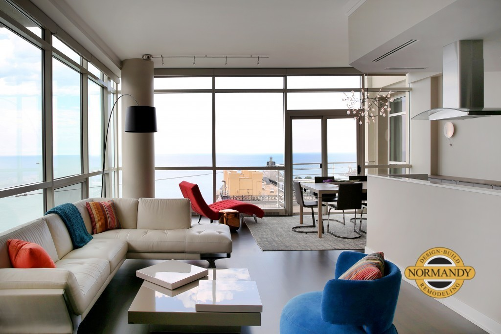 Open floorplan in Chicago condo merges kitchen and living room to gain view of Lake Michigan