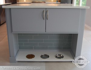 storage above food bowls in kitchen