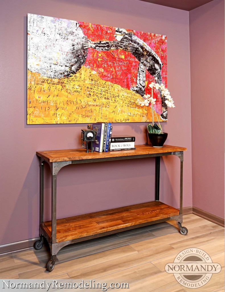 Basement with console table and artwork