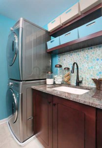 stained laundry room cabinets with blue accents