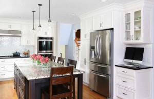 white kitchen cabinets with stained island
