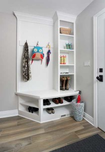 White mudroom with hooks and shelving