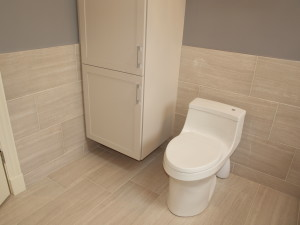 storage cabinet beside toilet