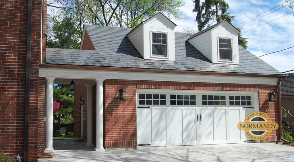 brick colonial house with garage addition and breezeway