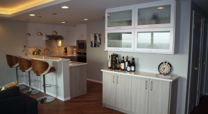 Chicago Galley Kitchen Pairs Glossy White Cabinets with Light Gray Stain