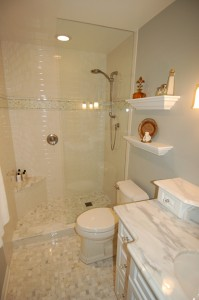 small bathroom feels larger with a partial glass shower wall