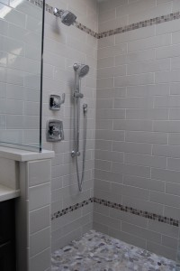 shower with pebble tile floor