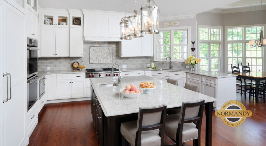 u-shaped white traditional kitchen with dark stained eat-in island