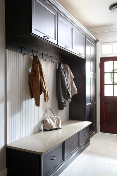 Mudroom space with cabinets and hooks for jackets