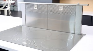 Induction cooktop with downdraft venting