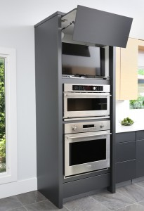 Wall ovens with concealed television above