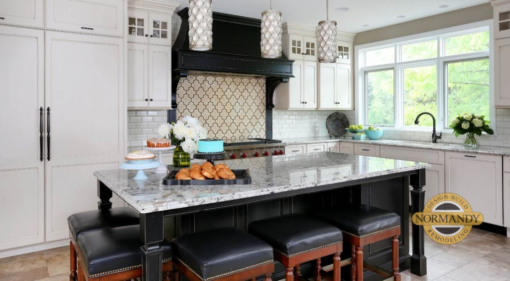 L shaped traditional kitchen with white and black cabinets