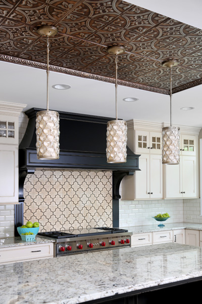 tin ceiling above the kitchen island