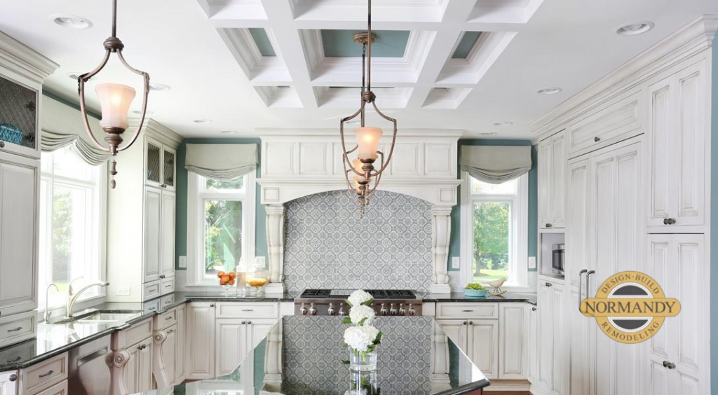 White painted kitchen cabinets with a coffered ceiling and robin's egg blue paint on the walls