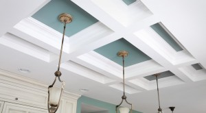 coffered ceiling beams with blue paint and pendant lights