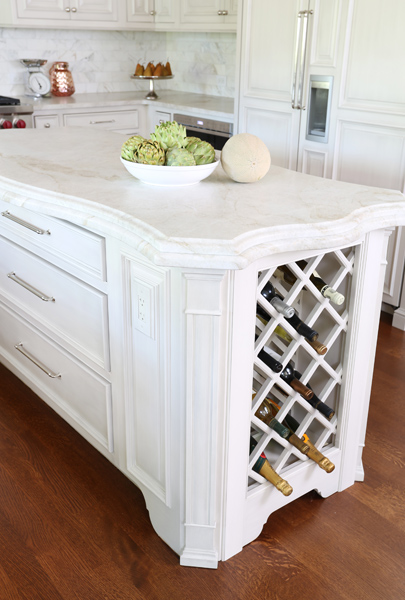 kitchen island with wine storage and contoured countertop