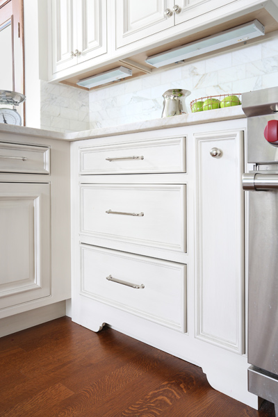 cabinet with trio of drawers with a custom spice pull out