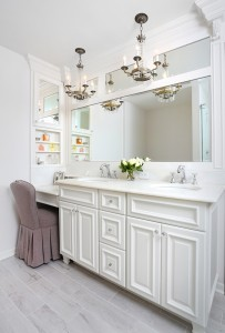 Master bathroom vanity with makeup table, chandeliers and divided mirrors