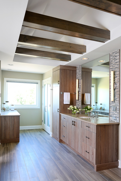 spa inspired master bathroom with ceiling beams and ample storage