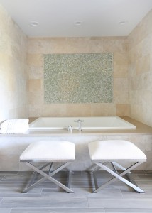 Large bathtub with decorative accents on the back wall