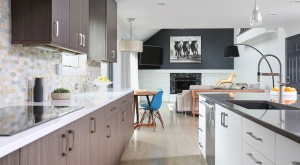 modern style kitchen open to adjoining living room