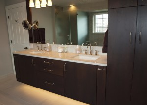 Master Bathroom with Floating Cabinets Illuminating the Floor Beneath
