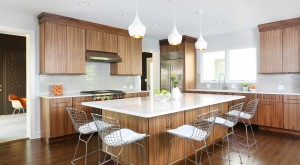 modern stained kitchen with wood tones and large island with seating