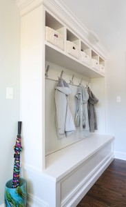 mudroom cabinetry with hooks for jackets and cubbies for personal effects