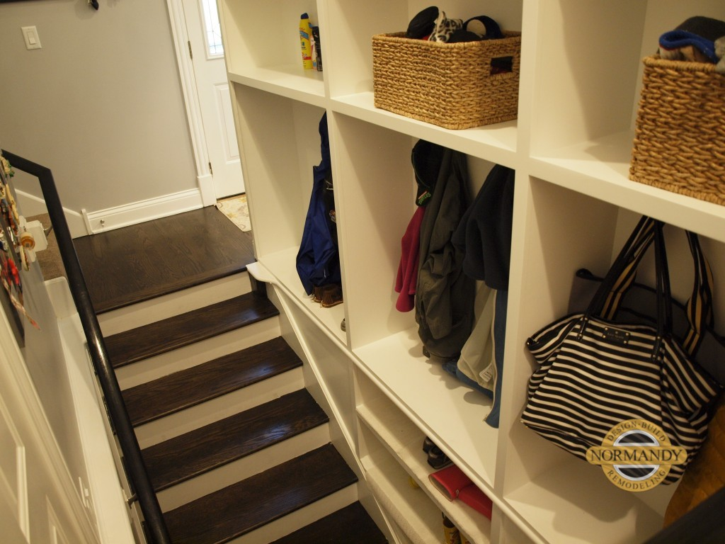 mudroom cubbies incorporated into basement stairwell