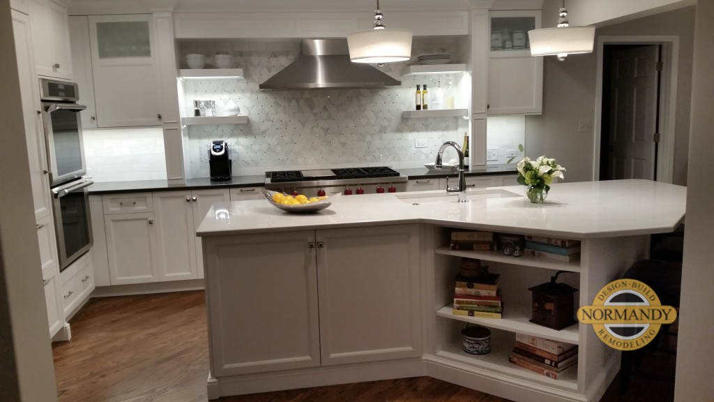 white and gray kitchen with open shelves and angled kitchen island