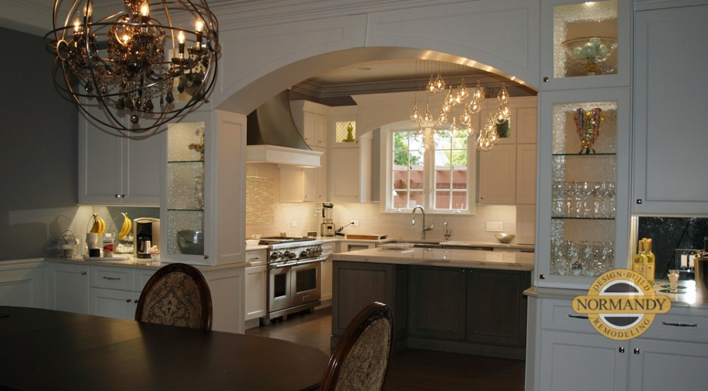 Dining room and kitchen are joined by a cabinetry arch