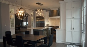 white kitchen with cabinetry arch that joins kitchen and dining room