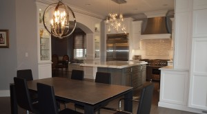 informal dining area, kitchen, and formal dining room are all connected in this open floorplan