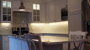 small white L shaped kitchen with island