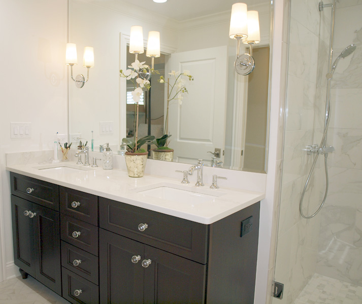 Double vanity in master bathroom as part of a master suite addition