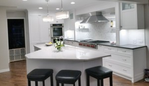 Unique island shape in this gray and white kitchen