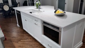 Kitchen island with appliance and sink