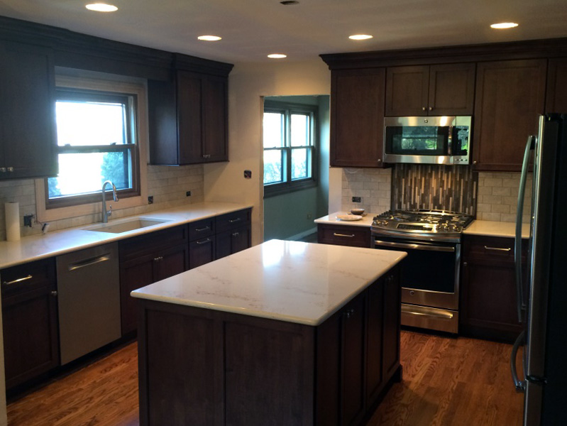 kitchen remodeled with dark stained cabinets