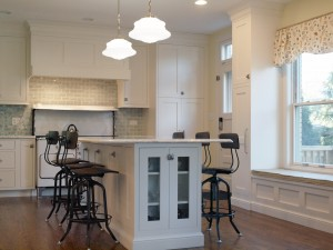 vintage inspired white kitchen with island seating