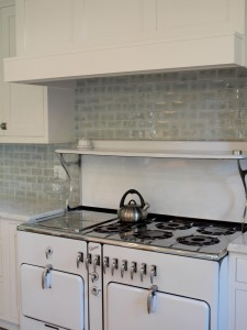 white kitchen with vintage stove