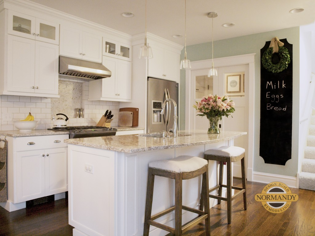 Small white kitchen with island on Chicago's North Shore