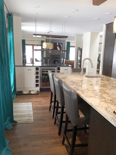 Suspended shelving and kitchen island with sink