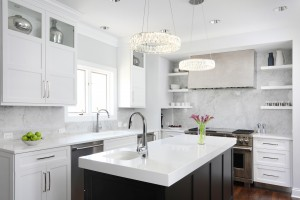 Glamorous white kitchen featuring shiny metal accents